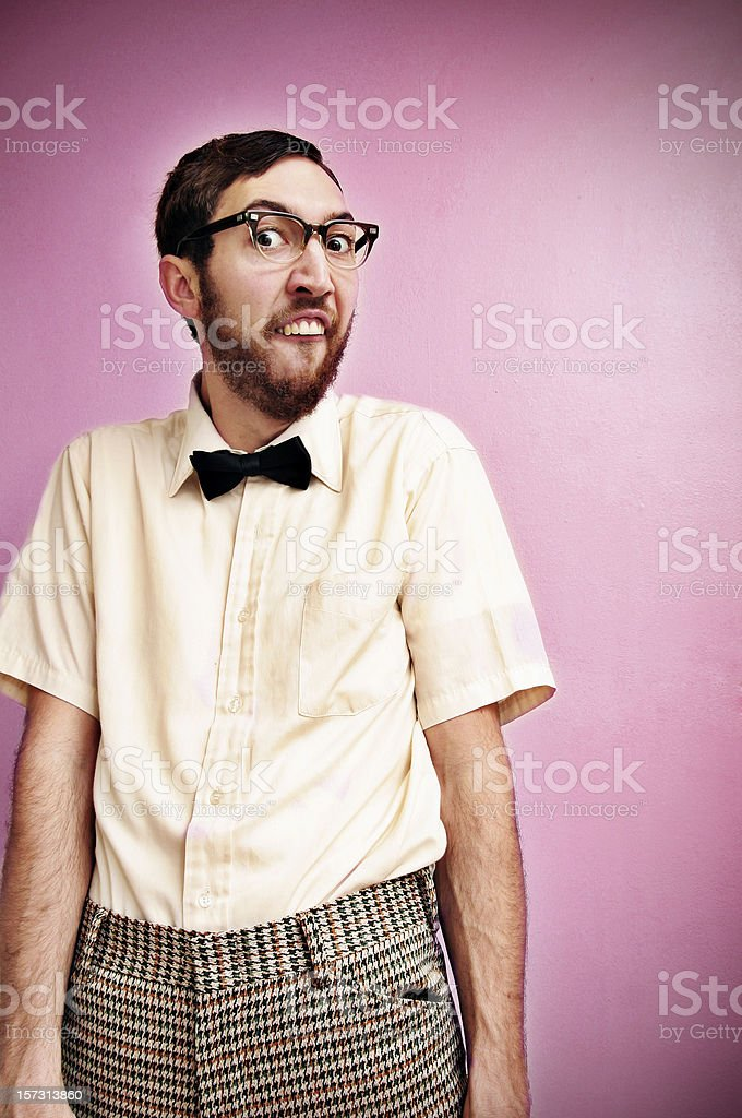 Nerd Guy With Glasses, Bow Tie, and Pink Background royalty-free stock photo
