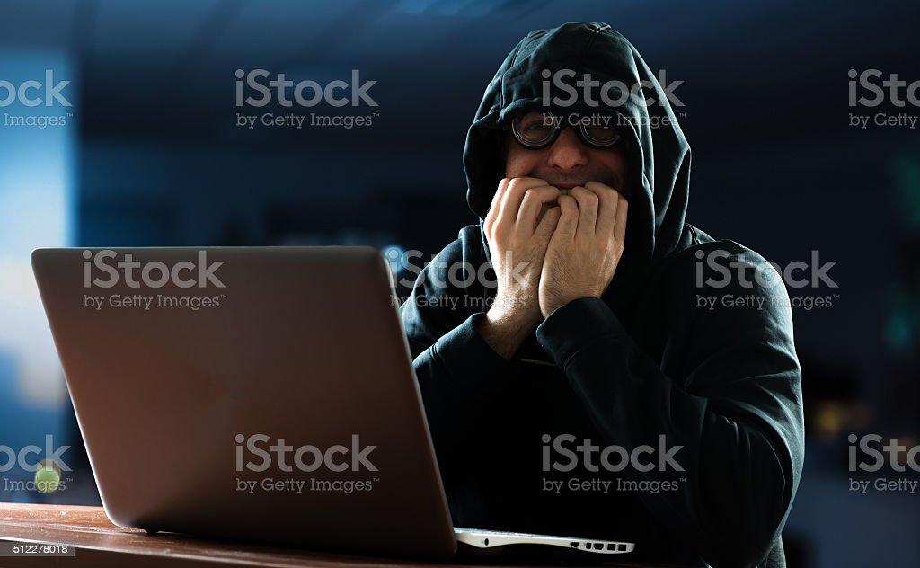 Nerd in front of his computer stock photo