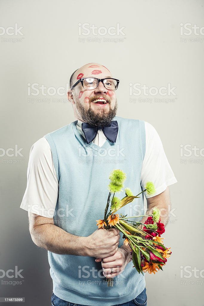 Nerd in Love Holding Bouquet of Flowers royalty-free stock photo