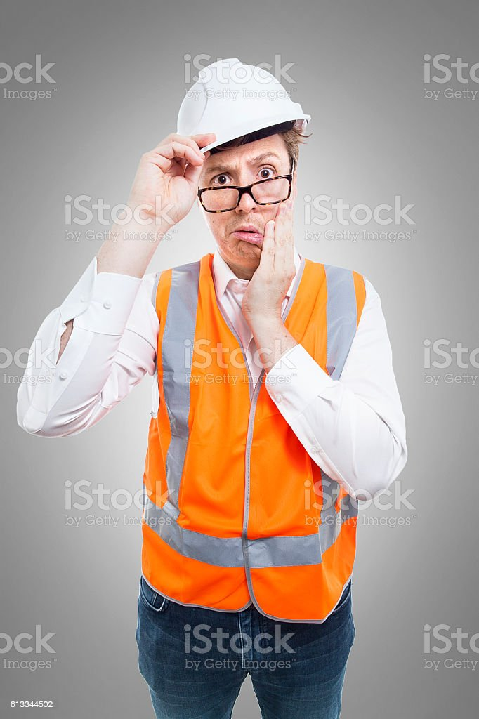 Nerd in safety gear is confused by something stock photo