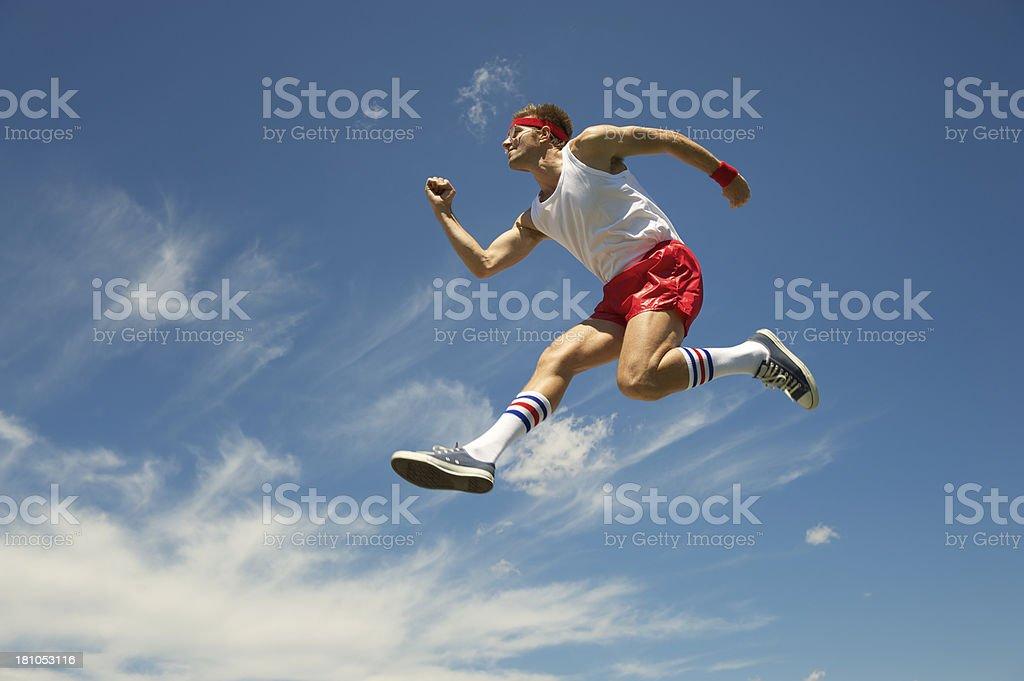 Nerd Jock Man Athlete Exercises by Jumping Blue Sky royalty-free stock photo