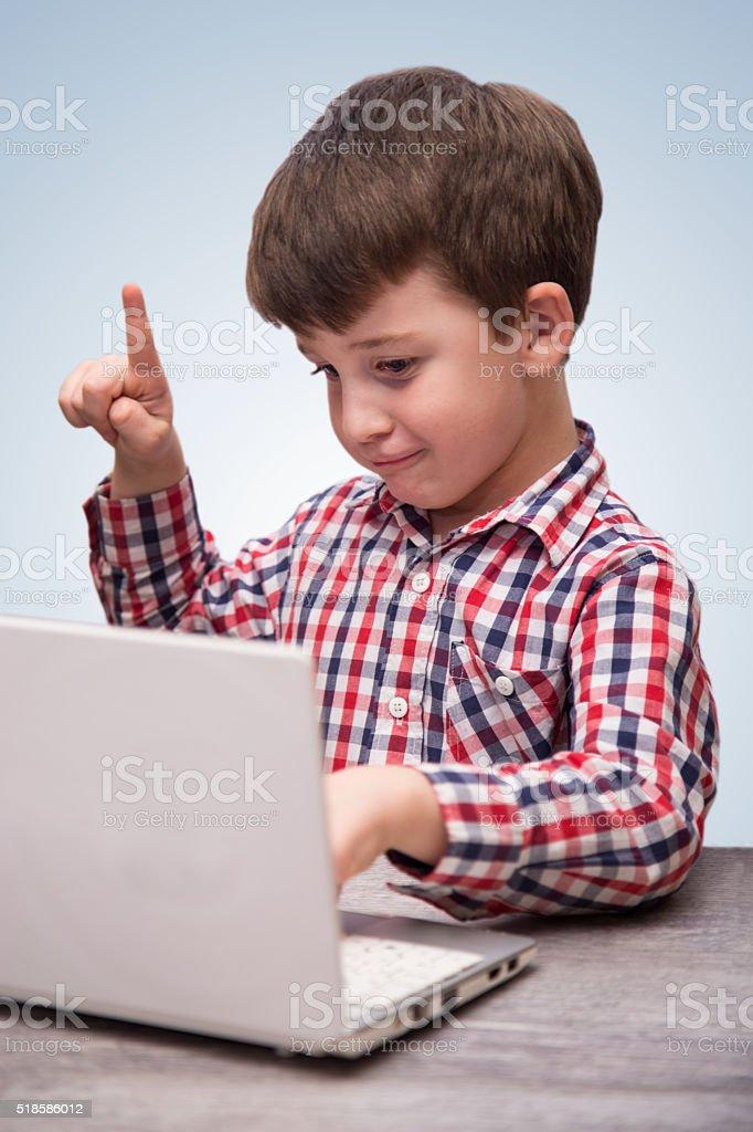nerd kid has an idea stock photo