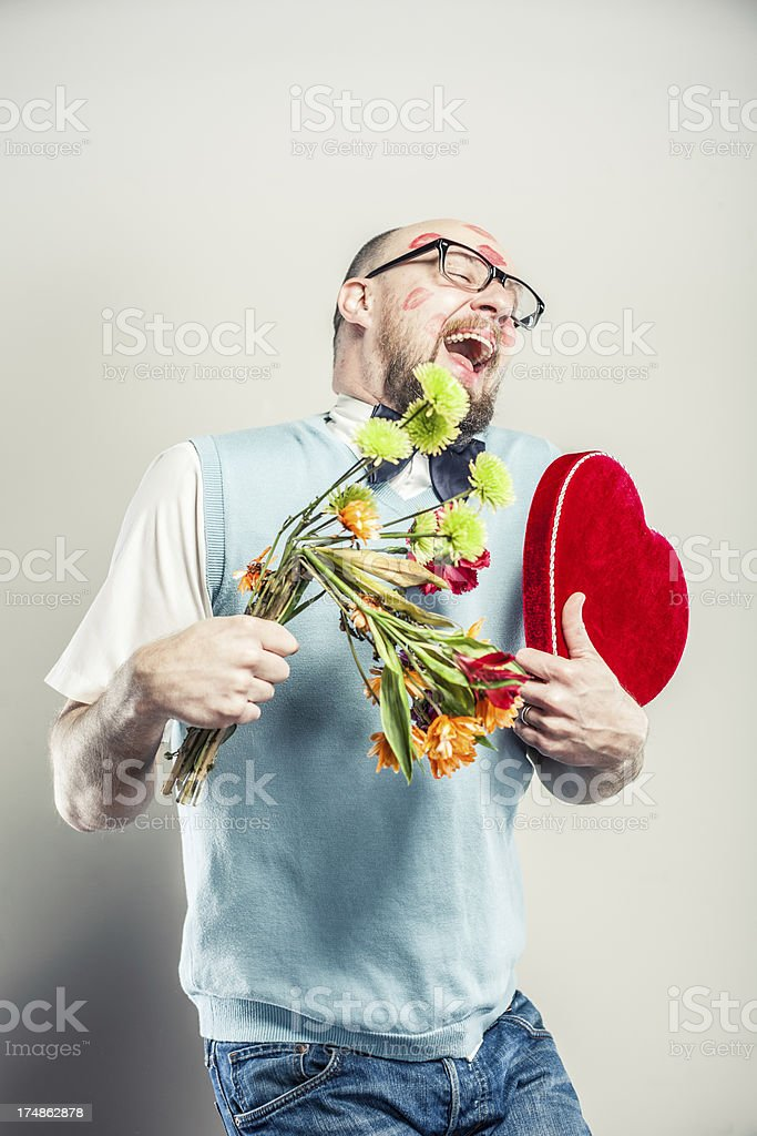 Nerd Laughing Holding Flowers and Heart royalty-free stock photo