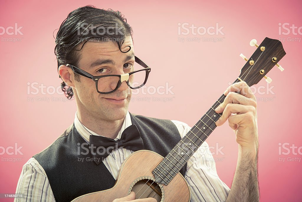 Nerd makes a serenade to his girlfriend royalty-free stock photo