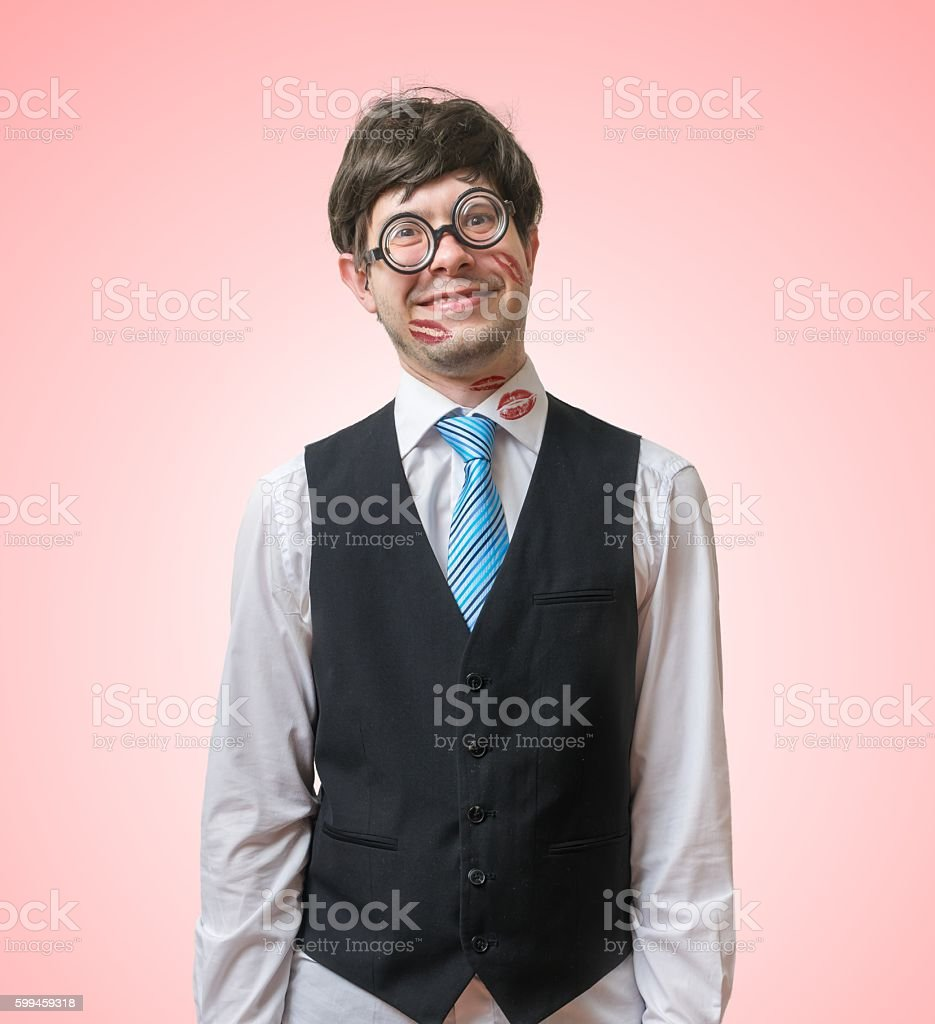 Nerd or geek in love with lipstick kisses on face. stock photo