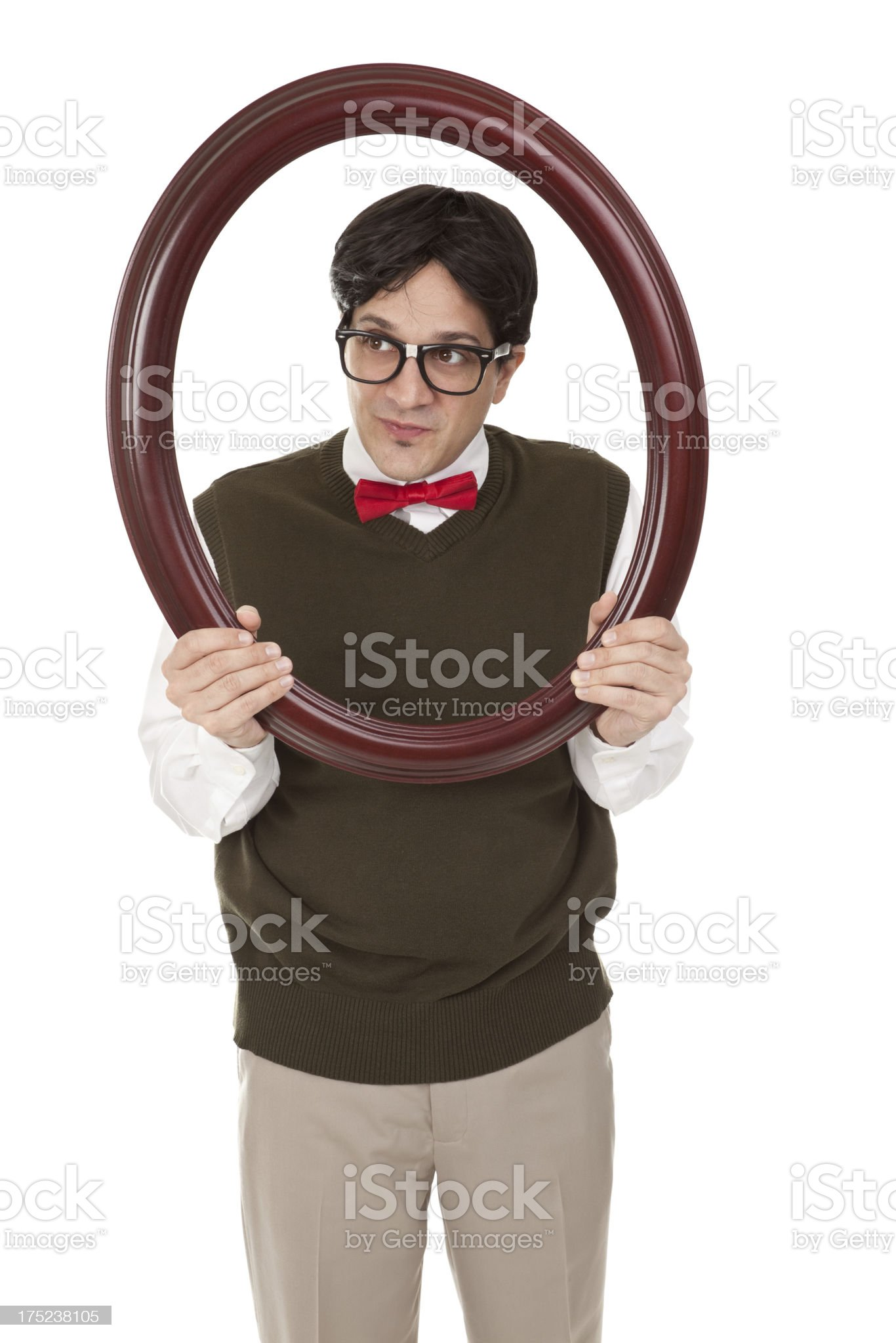 Nerd Posing Though Picture Frame Isolated On Whte royalty-free stock photo