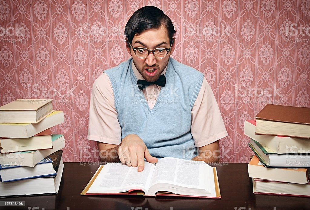 Nerd Student Studies His Homework Hard stock photo