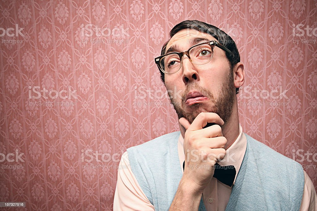 Nerd Student Thinking Hard with Retro Glasses stock photo