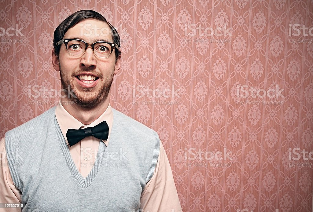 Nerd Student With Retro Glasses and Pink Wallpaper stock photo