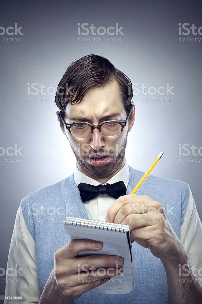 Nerd Student Writing in Notepad with Pencil stock photo