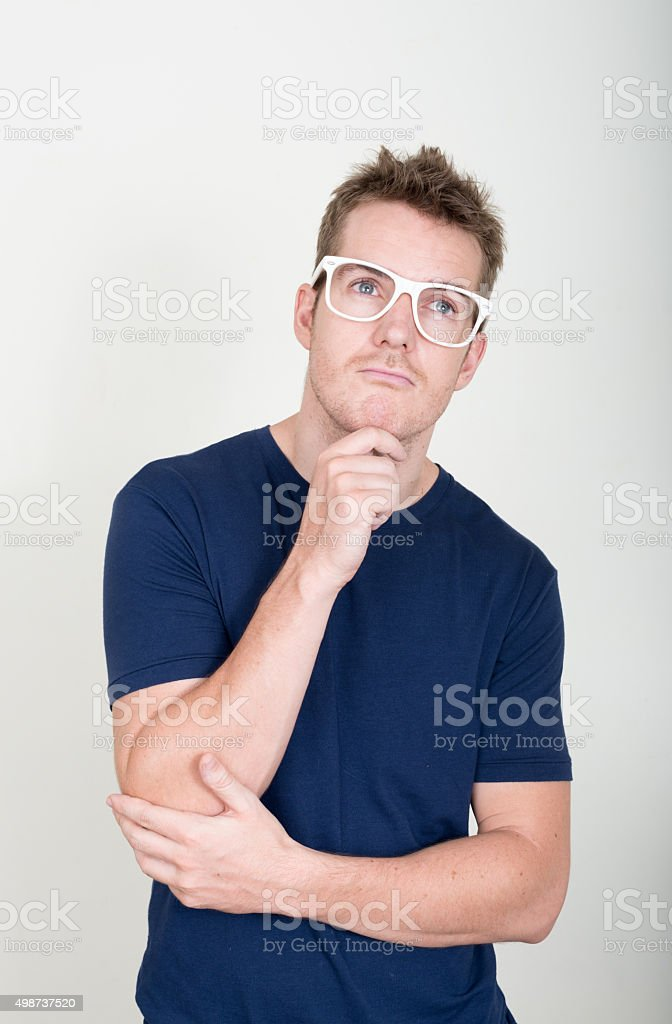 Nerd thinking and looking up stock photo