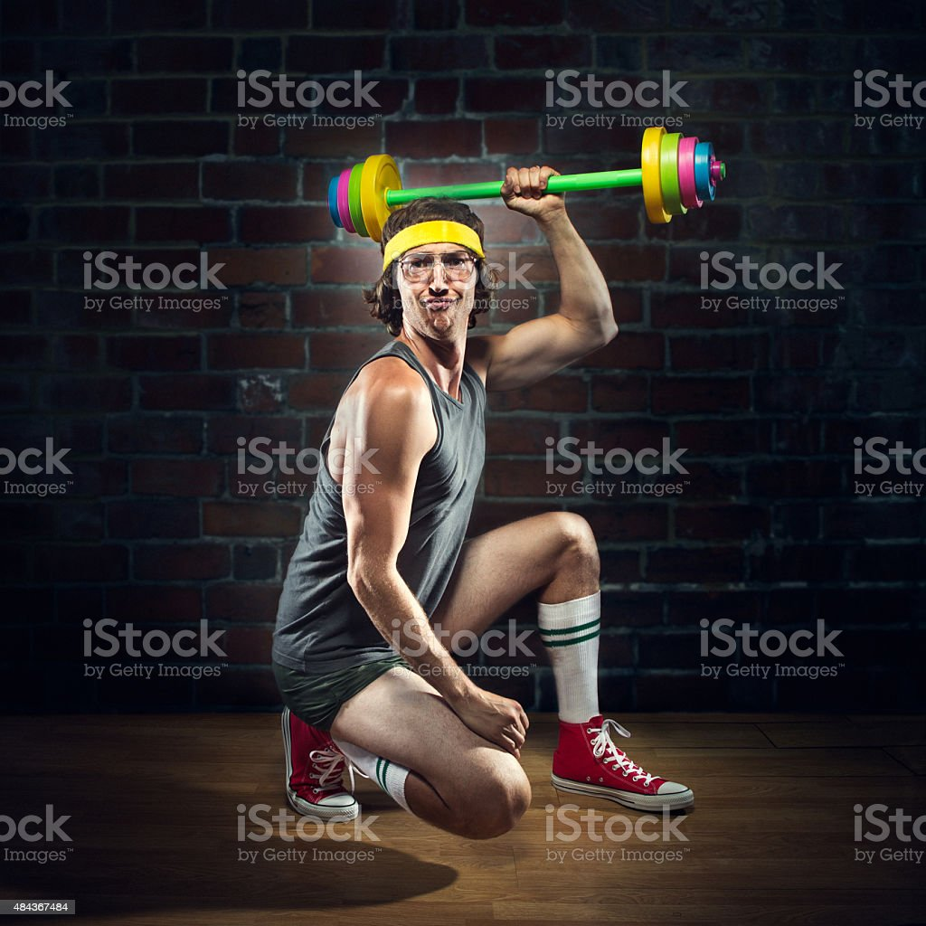 Nerd Weightlifter Lifting Childrens Toy Barbell stock photo