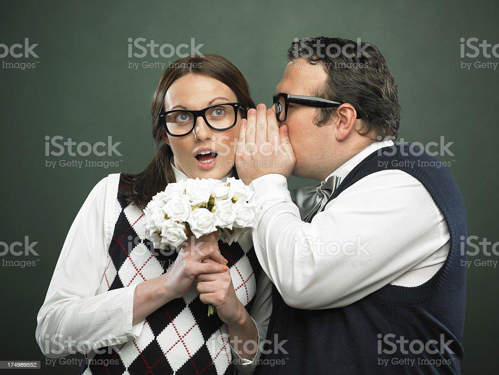Nerd whispering on ear royalty-free stock photo