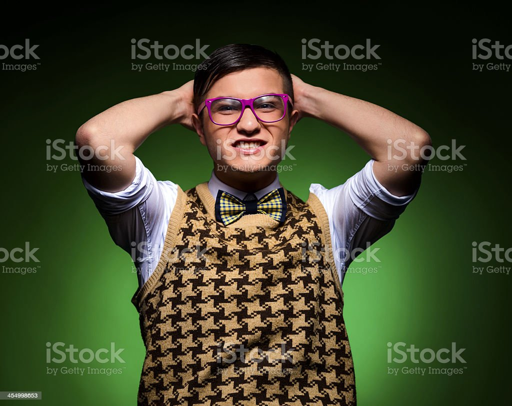 nerd with hands behind head royalty-free stock photo
