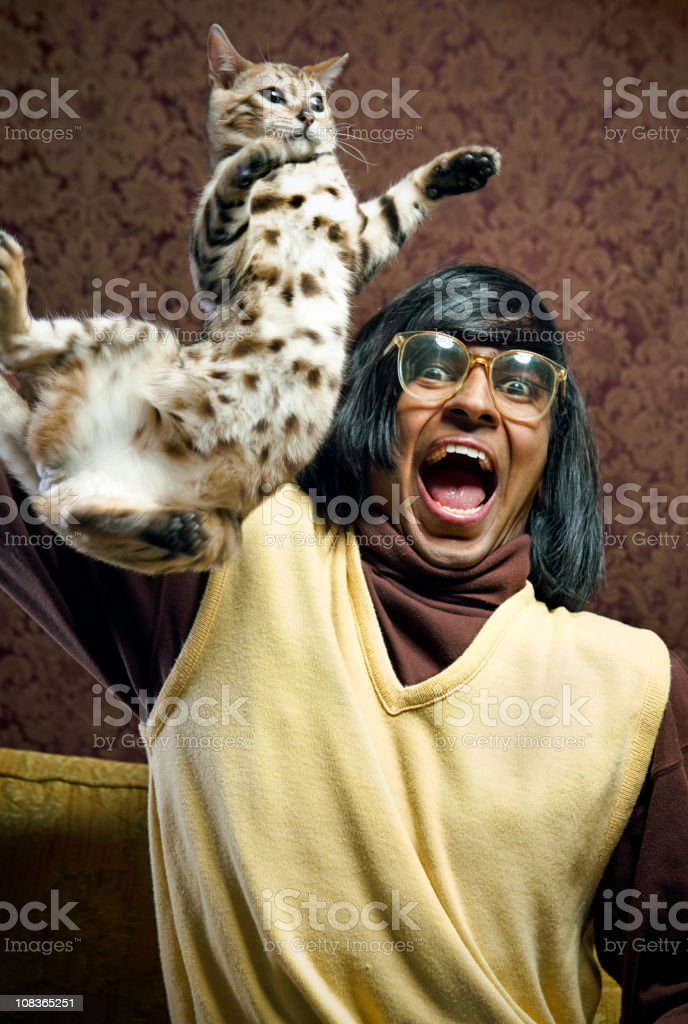 Nerd With His Flying Cat stock photo