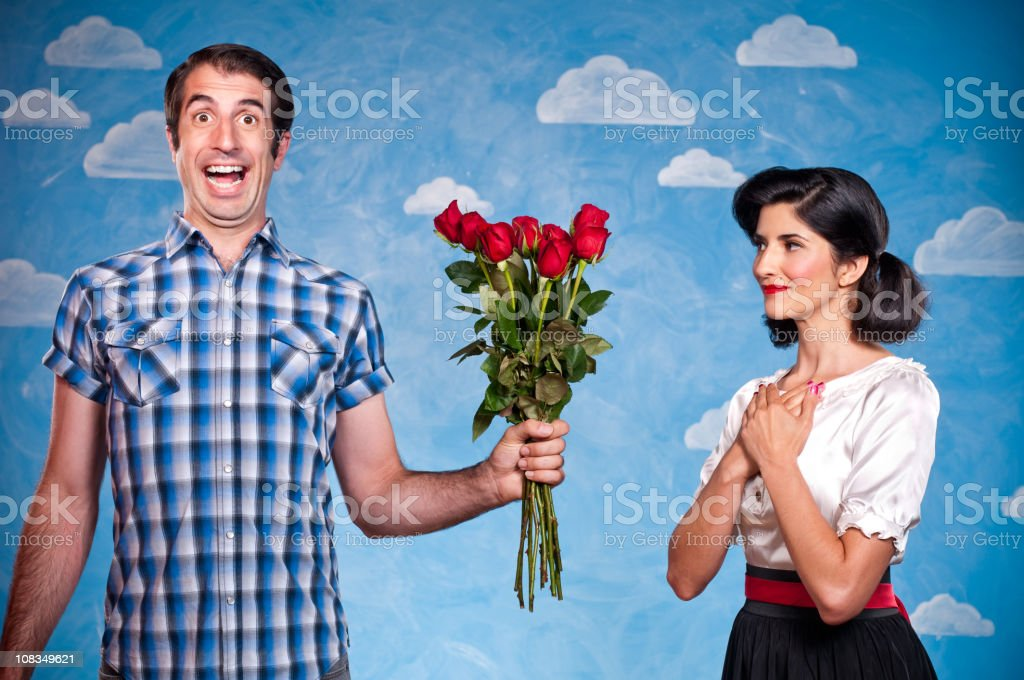 Nerd With Red Roses On A Date royalty-free stock photo