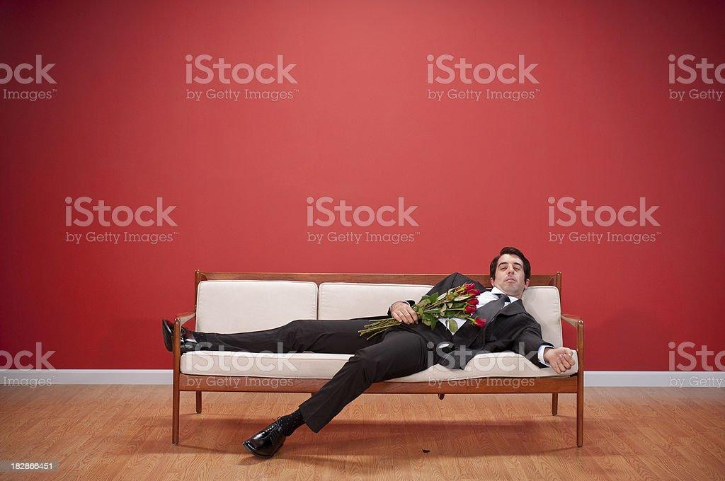 Nerd With Roses Falls Asleep stock photo