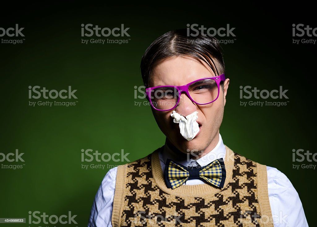 nerd with tissue in nose royalty-free stock photo