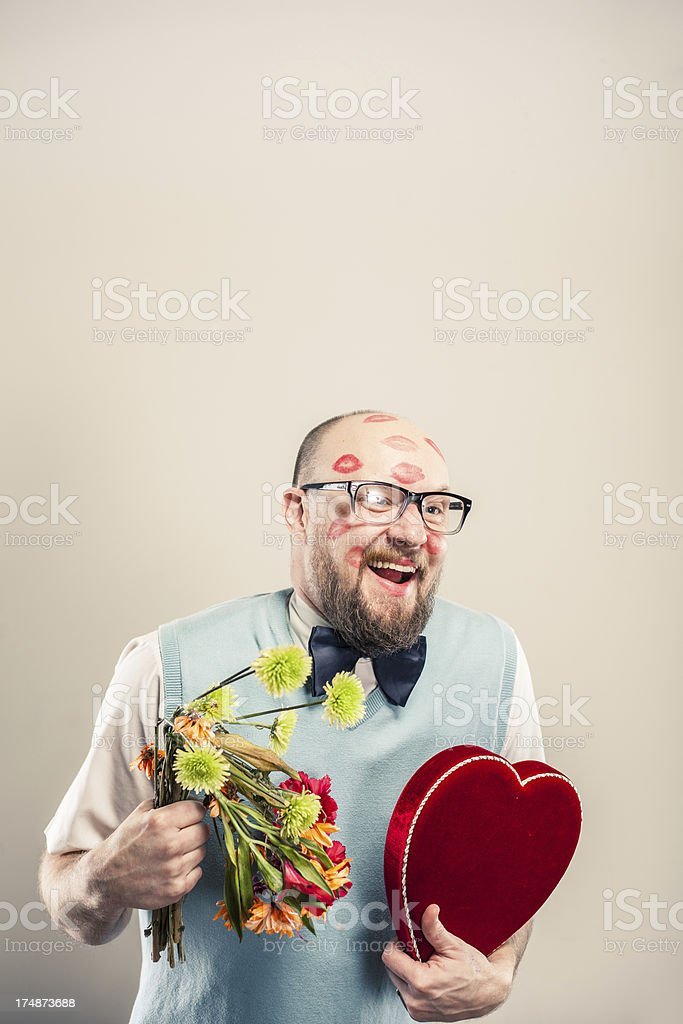 Nerd with Valentine's Day Gifts royalty-free stock photo