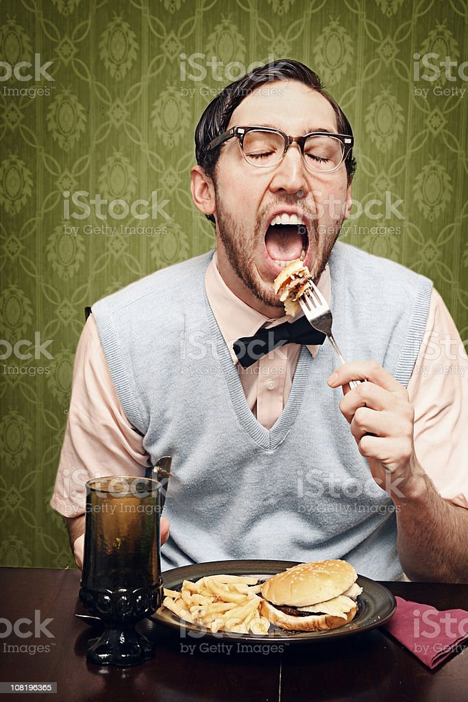 Nerd Young Man Eating Dinner royalty-free stock photo