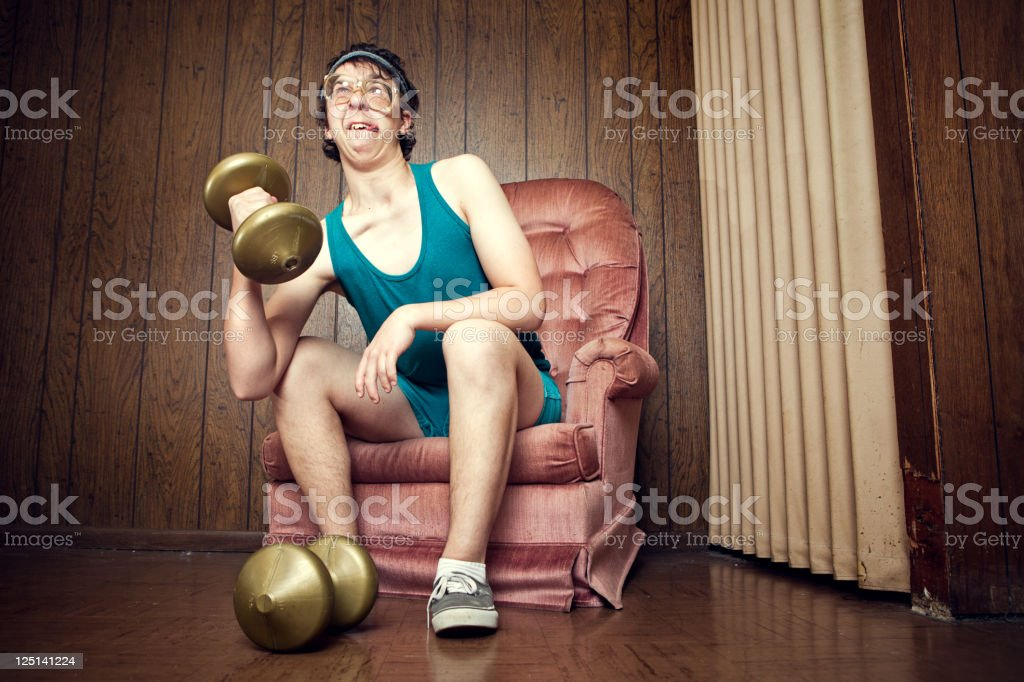 Nerd Young Man Exercising with Weights royalty-free stock photo