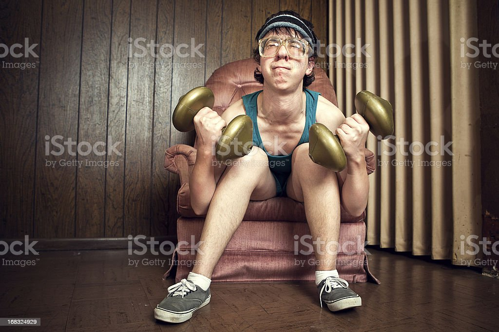 Nerd Young Man Exercising with Weights stock photo