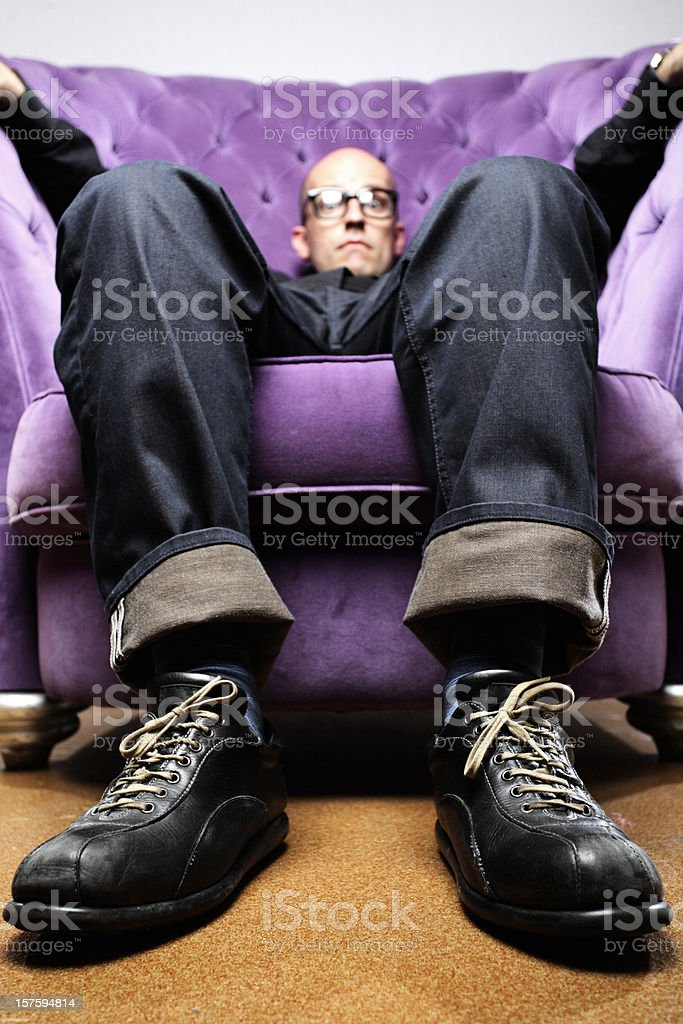 nerdish looking man with two left feet _ Vertical royalty-free stock photo