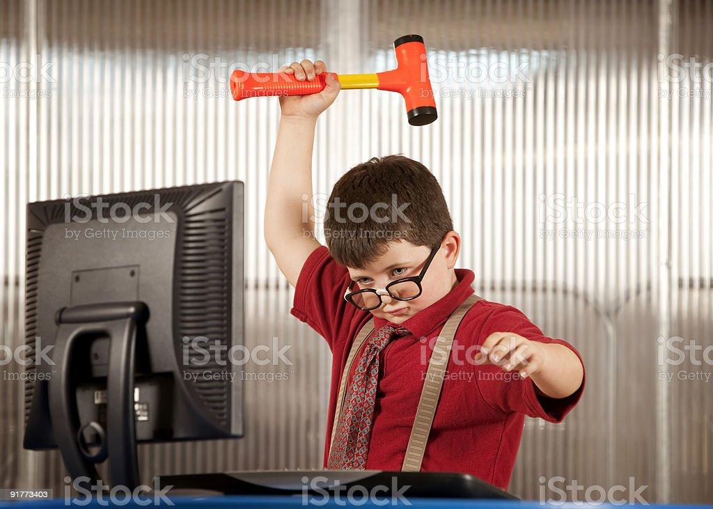 Nerdy boy smashing his computer royalty-free stock photo