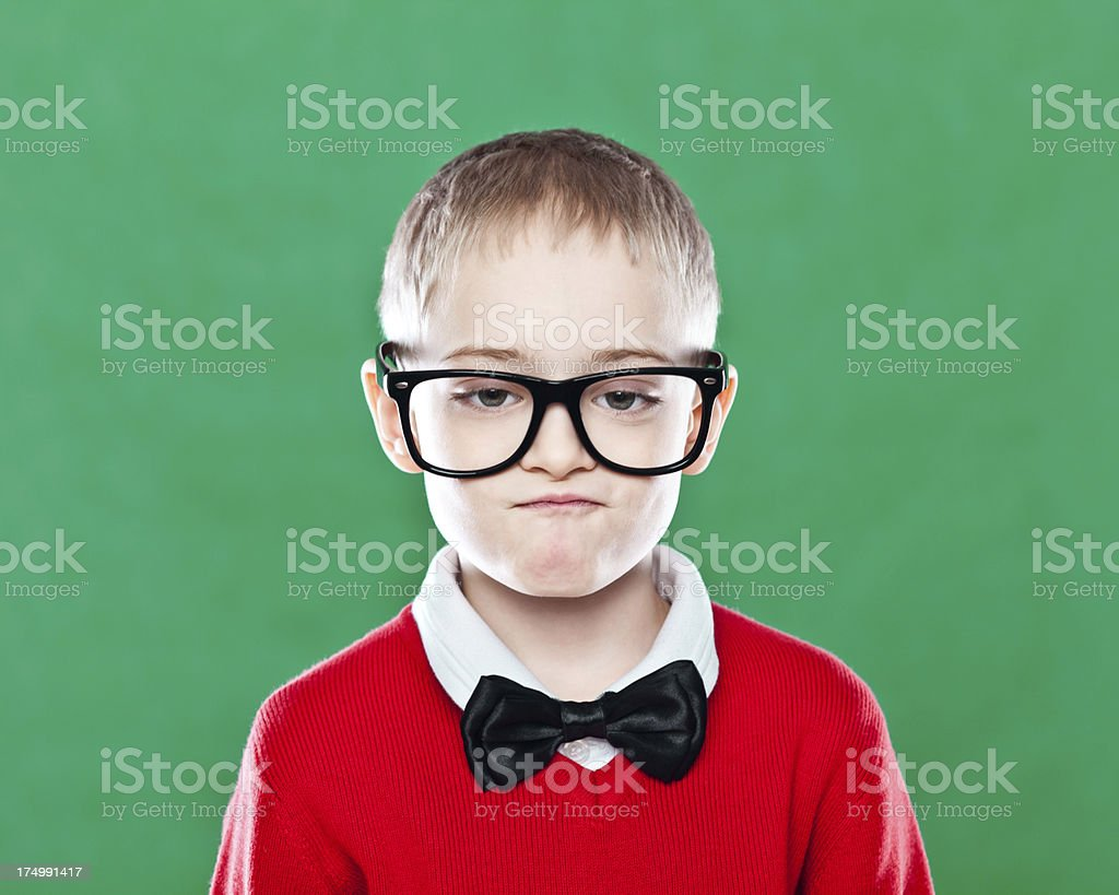 Nerdy Boy with Bow Tie and Glasses stock photo