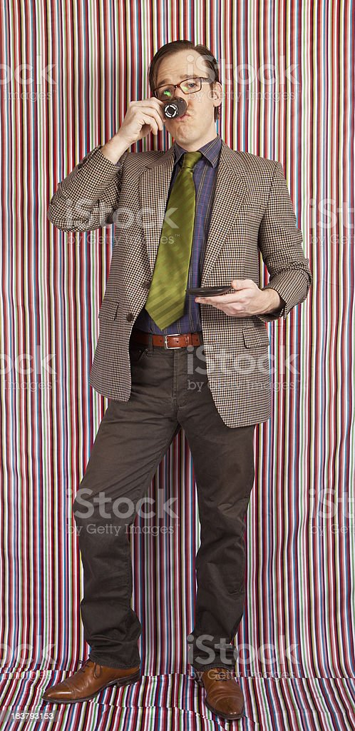 Nerdy businessman having a cup of coffee royalty-free stock photo