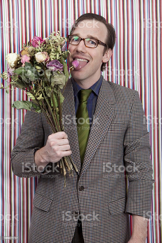 Nerdy businessman licking a bunch of flowers royalty-free stock photo