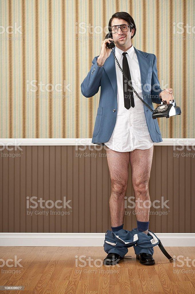 Nerdy Businessman Speaking On Vintage Telephone royalty-free stock photo
