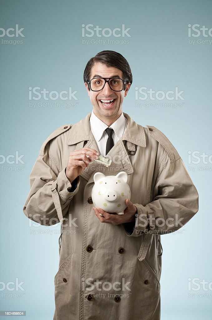 Nerdy Businessman With Piggy Bank. royalty-free stock photo