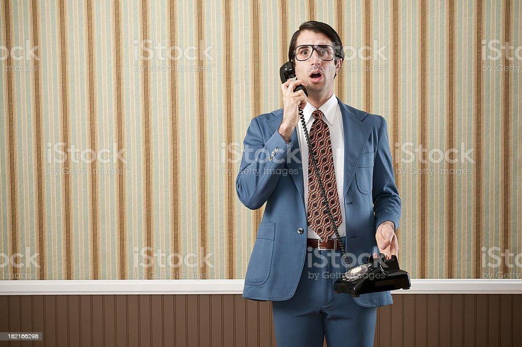 Nerdy BusinessmanSpeaking On Vintage Telephone stock photo