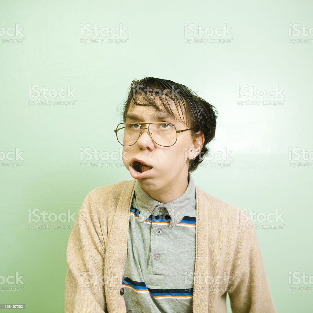 Nerdy dude with wild facial expression stock photo
