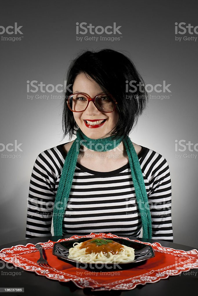 Nerdy girl eating spaghetti royalty-free stock photo