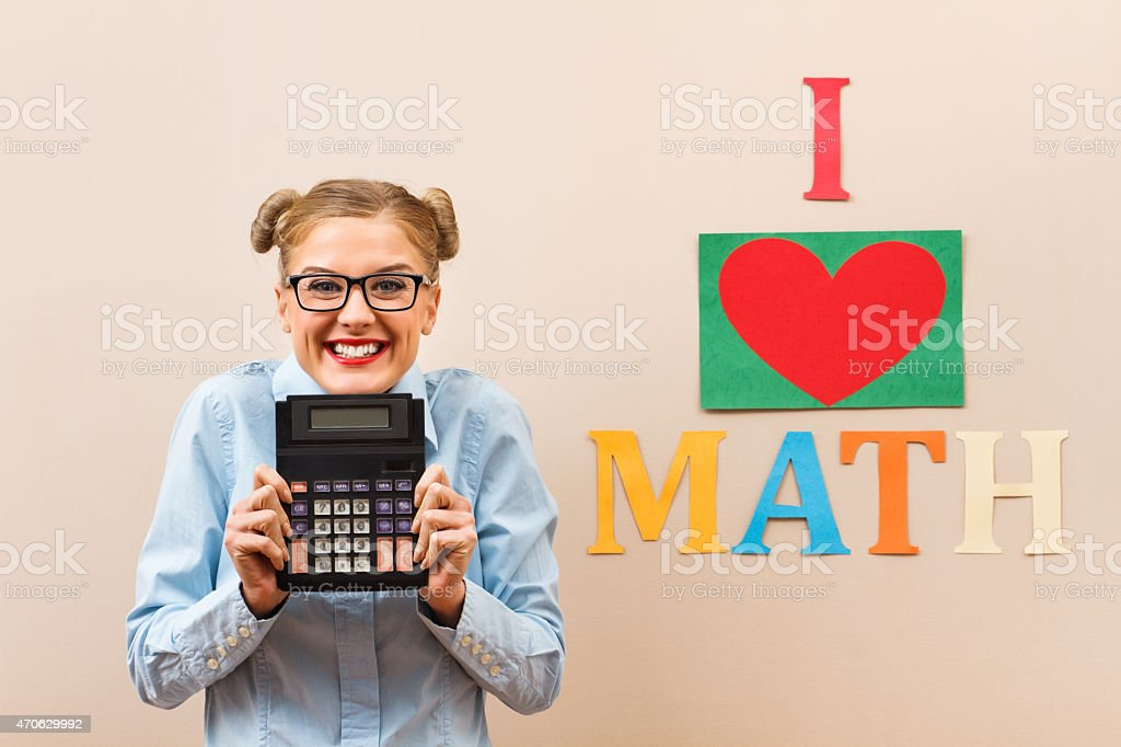 Nerdy girl loves math and holds calculator stock photo