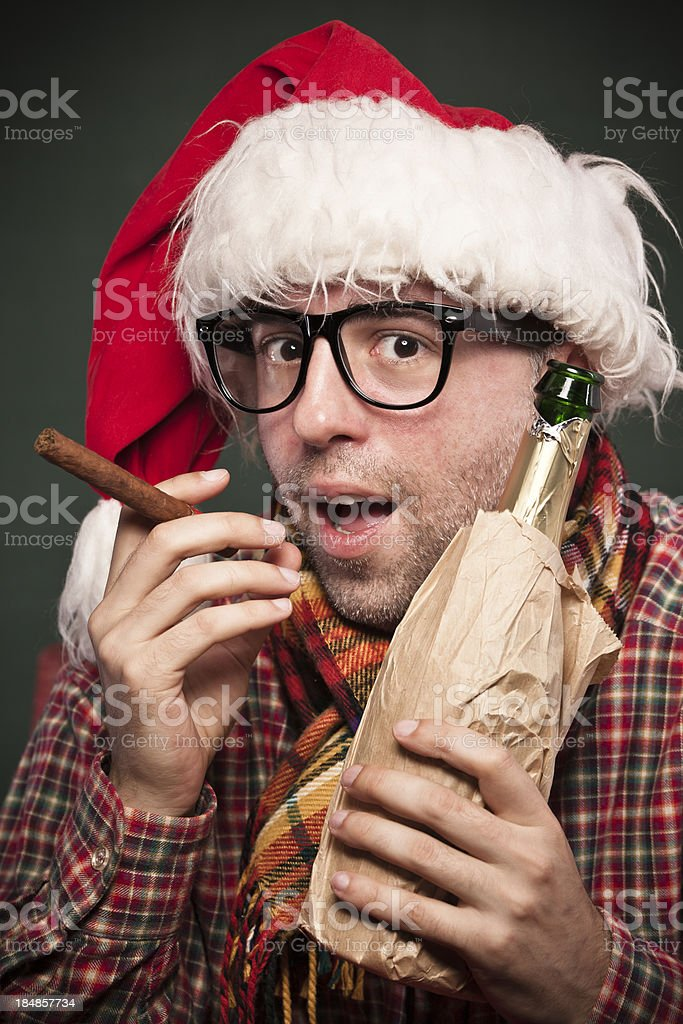 Nerdy guy celebrating New Year's Eve royalty-free stock photo