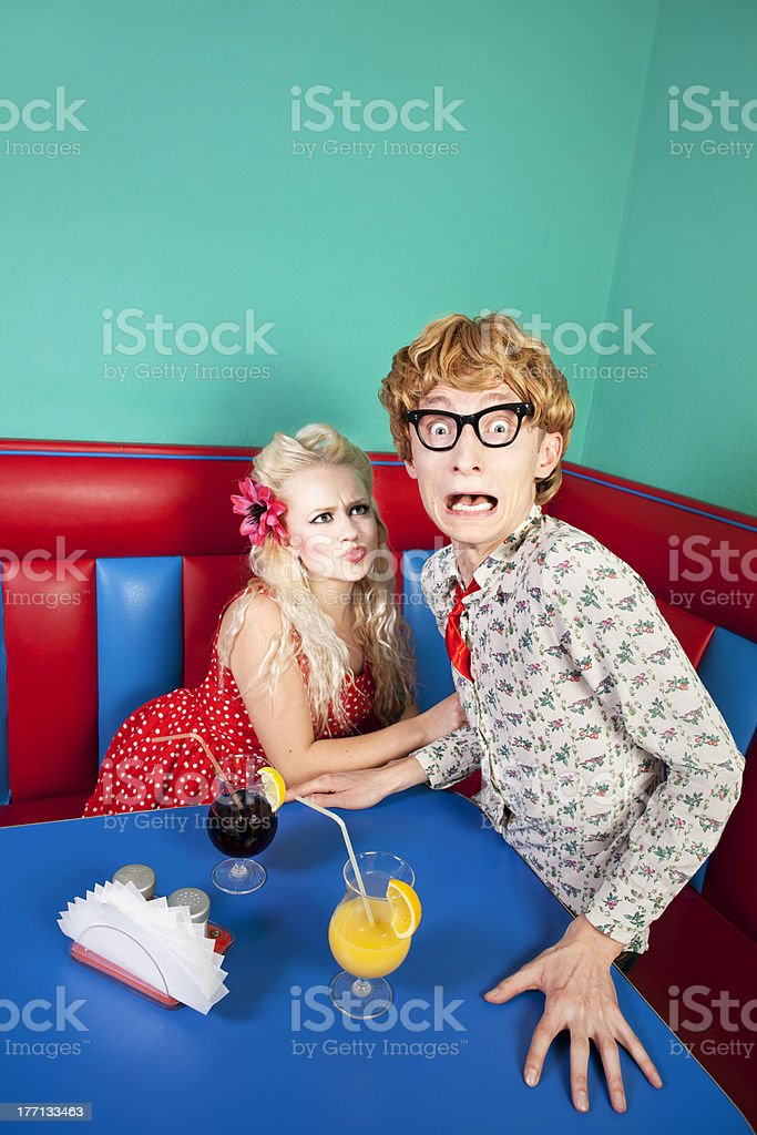 Nerdy guy escaping from his girlfriend stock photo