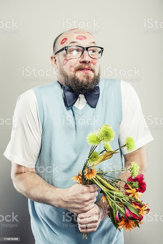 Nerdy Guy holding Colorful Bouquet of Flowers royalty-free stock photo
