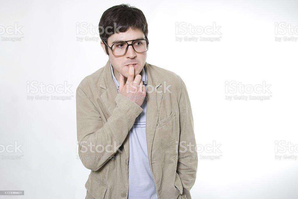 nerdy guy thinking royalty-free stock photo