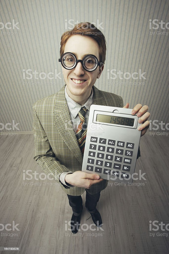 Nerdy guy with a giant-sized calculator royalty-free stock photo