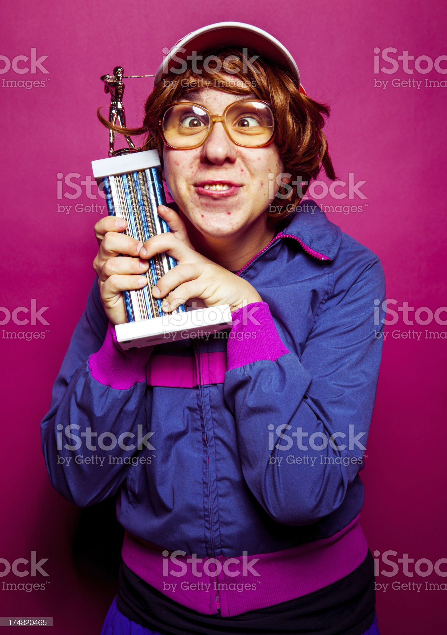 Nerdy guy with trophy royalty-free stock photo