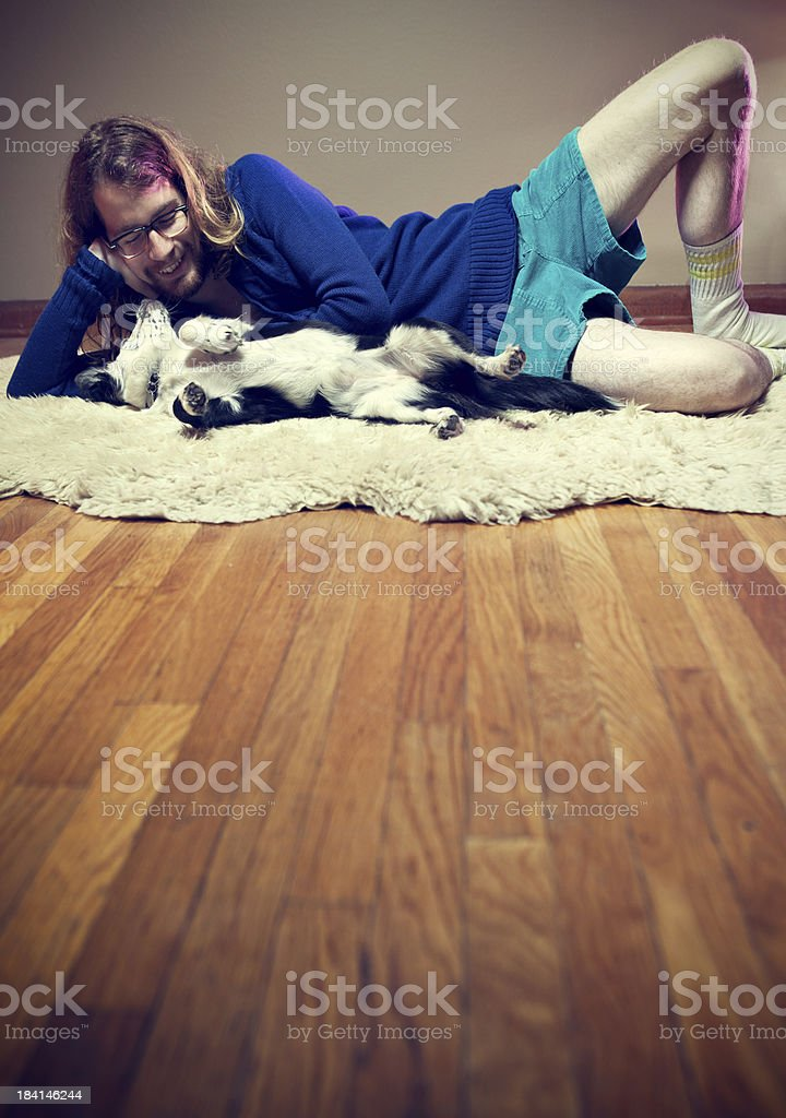 Nerdy Ladies Man with Puppy on Shag Rug royalty-free stock photo