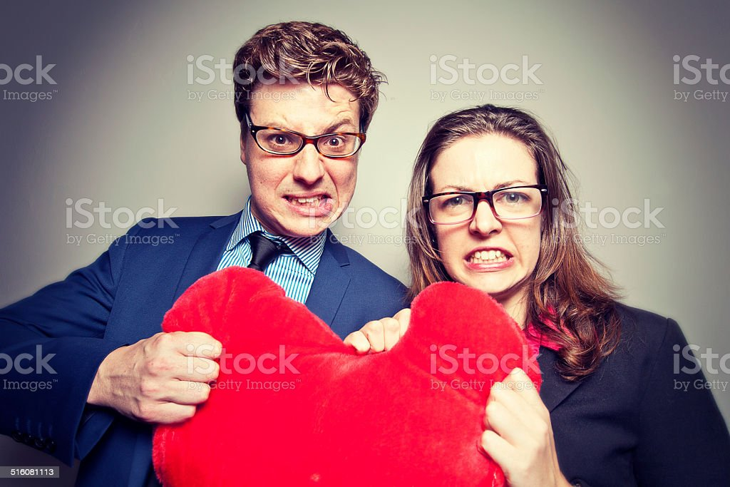 Nerdy lovers fighting stock photo