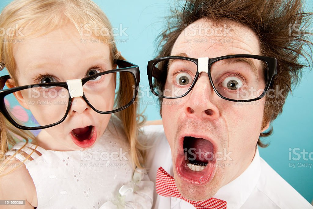 Nerdy Man and Little Girl Gasping with Look of Surprise royalty-free stock photo