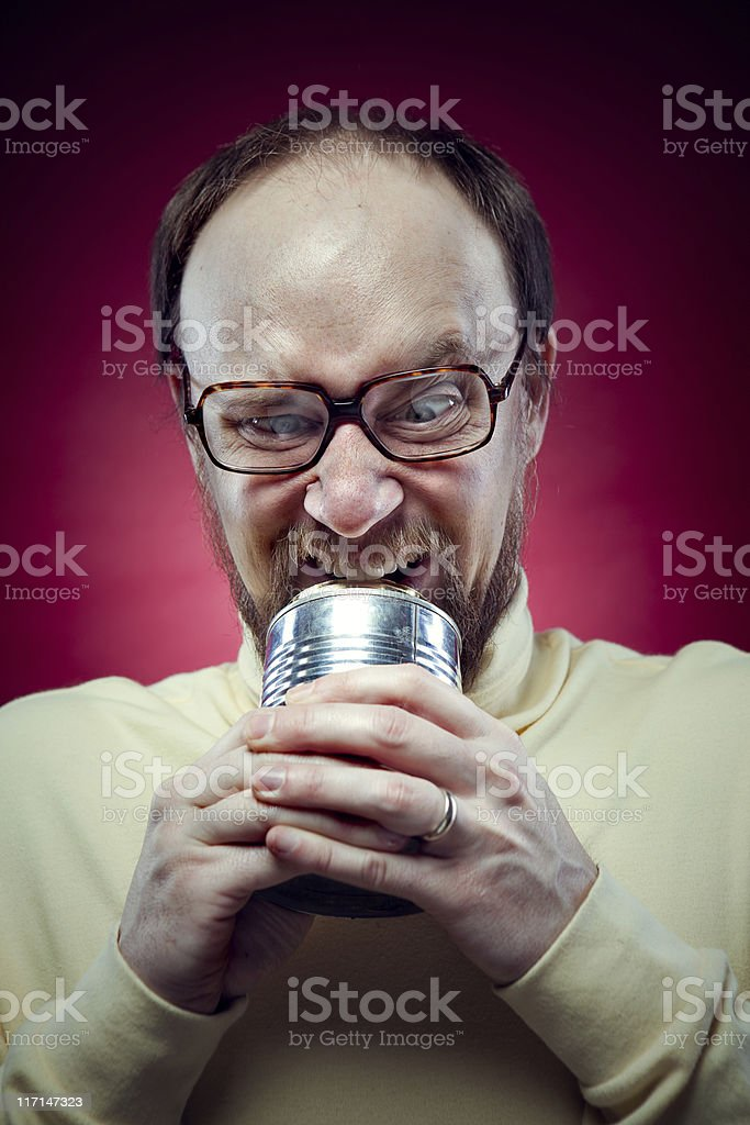 Nerdy Man Opening Can with Teeth stock photo