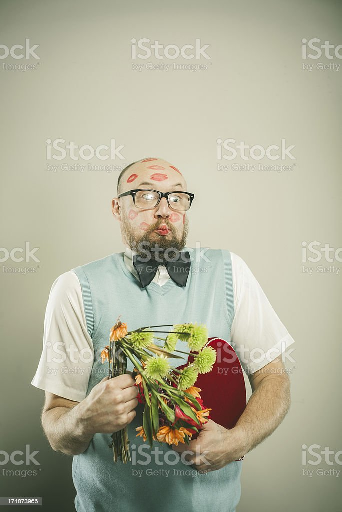 Nerdy Man Puckering his Lips Holding Valentine Gifts royalty-free stock photo