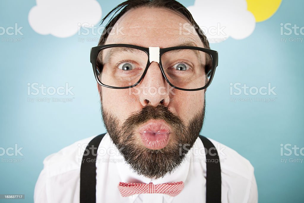 Nerdy Man Puckering Up for a Kiss stock photo