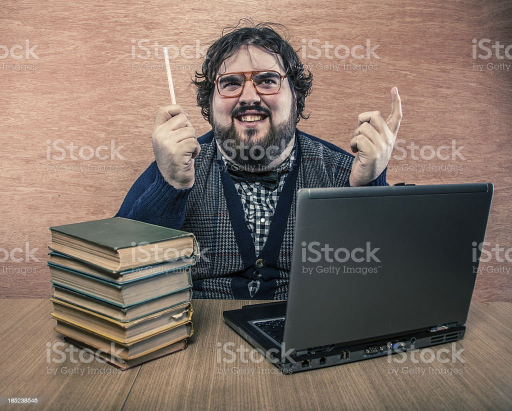 Nerdy Man with Books and Laptop, Squinting at Cieling royalty-free stock photo